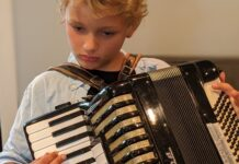 Boy must grow into this accordion